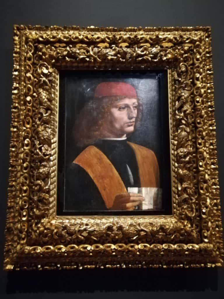 楽譜を持つ若い男性の肖像画 « ミュージシャン »